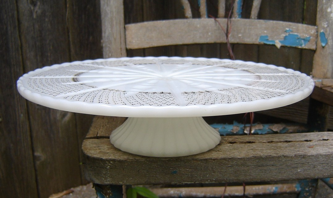 Or perhaps this vintage 1950 39s milk glass cake stand with gold trim