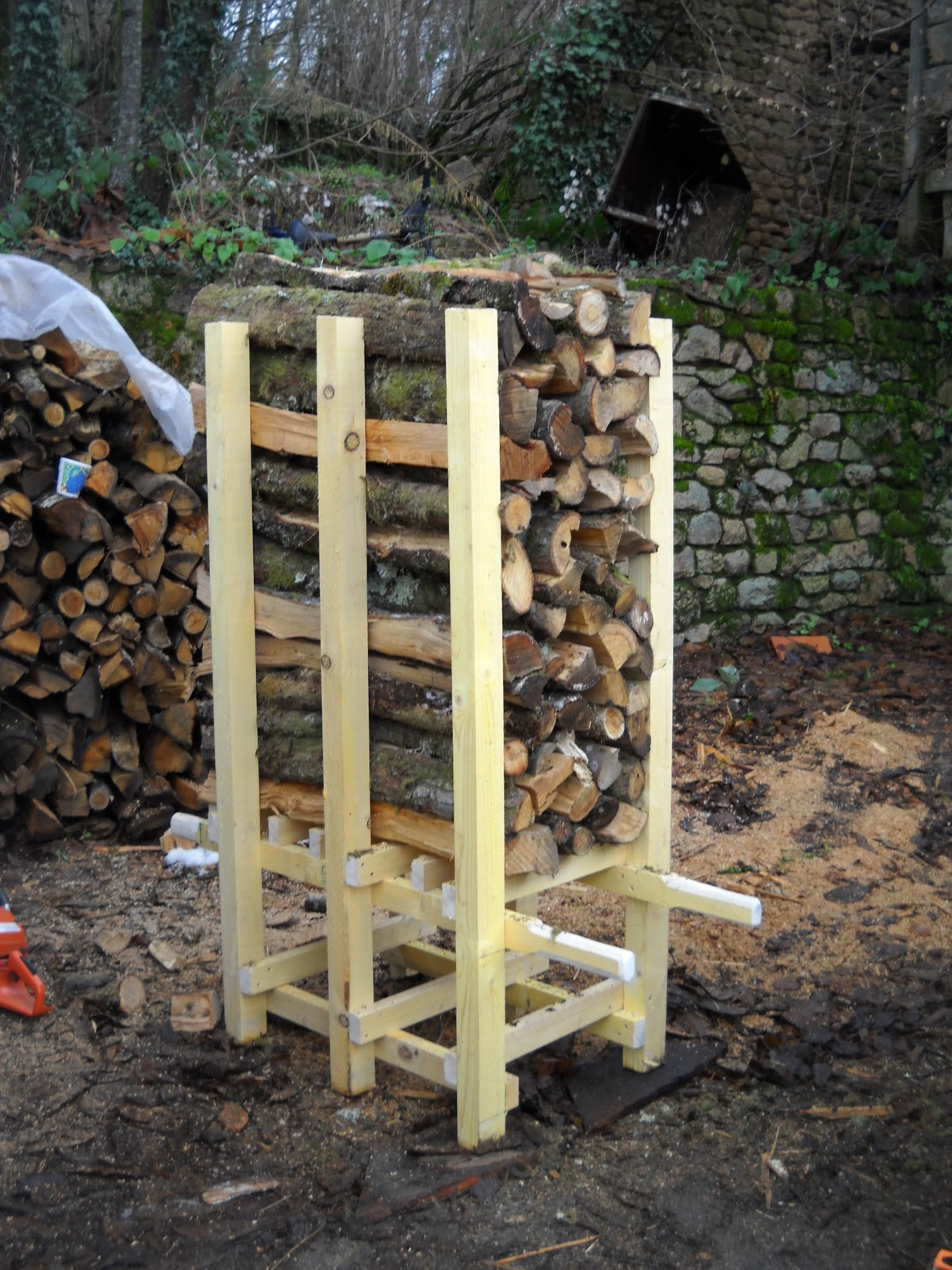 The logs are packed as solidly as possible into the frame which