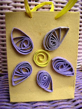 Small gift bag with purple quilled paper flower and yellow ribbon