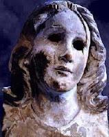 la testa della statua di Maria