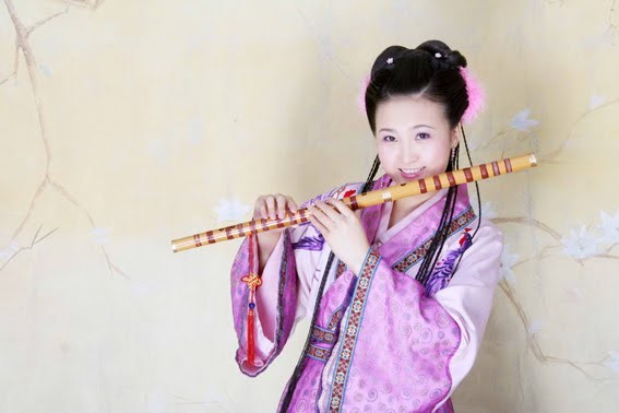 Hot babe asian playing flute