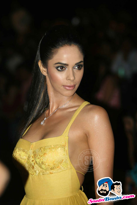 Mallika Sherawat sizzles in Yellow at Lakme Fashion Week 2010