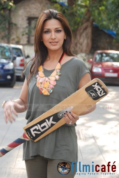 Sonali Bendre With a Bat in her Hand