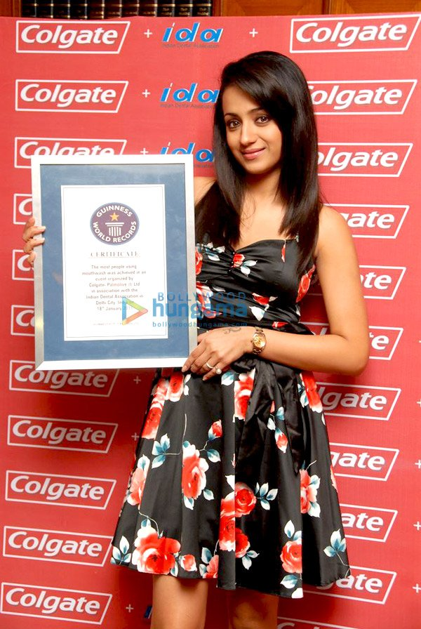 Trisha Krishnan poses with Guinness World Records certificate for Colgate and IDA