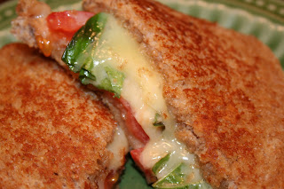 Oprah's Favorite Grilled Cheese with havarti, tomato, basil, honey and whole wheat bread #sandwich #recipe ohsweetbasil.com