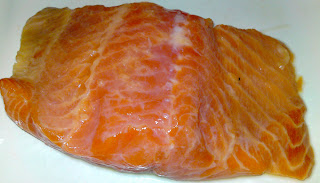 Raw salmon, splashed with lemon juice
