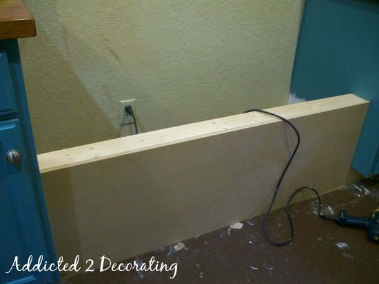 Using MDF to cover the front of the banquette bench with storage