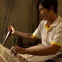 Prae Pan member at her loom
