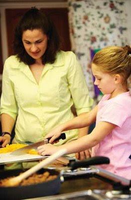 NAMC modeling montessori behavior at home girl mom making food