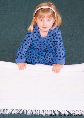 NAMC Montessori classroom motor skills development girl rolling mat
