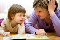 NAMC montessori community create parent volunteer handbook mother and young girl reading