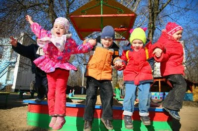 NAMC montessori preschool outdoor activities social development children jumping on playground