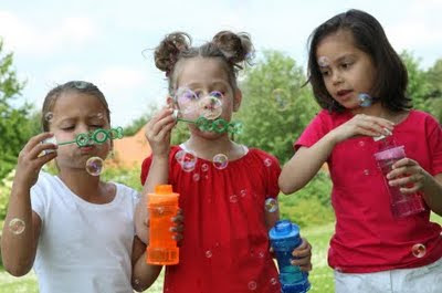 NAMC montessori preschool outdoor activities social development children blowing bubbles