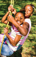 NAMC montessori academic social competition classroom girls on swing