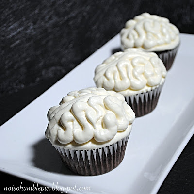 chocolate ganache-filled brain cupcakes by notsonumblepie