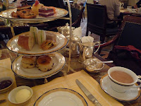 The traditional high tea with silver tea service.