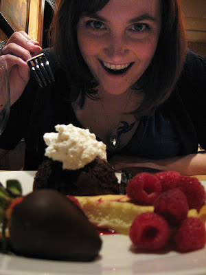 dana prepares to devour our entire plate of desserts in a single bite