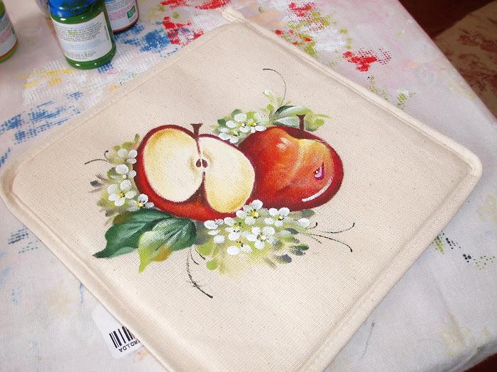 pegas de maçãs amiga Odilia