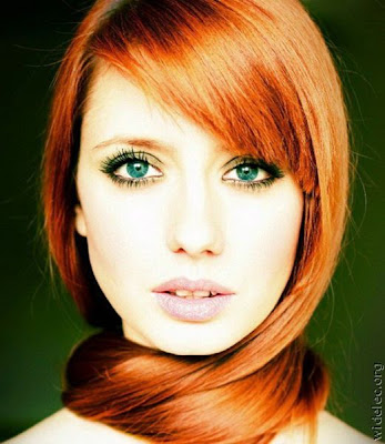 Beautiful Girl With Red Hair And Green Eyes