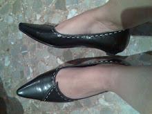 zapatos usados con pespunte