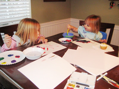 Grandkids painting in watercolors
