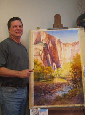 Artist Roland Lee with new painting of Zion National Park