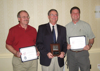 Nick Jorgenson, Lyman Hafen, and Roland Lee receiving publication awards at the 2009 APPL conference in Baltimore