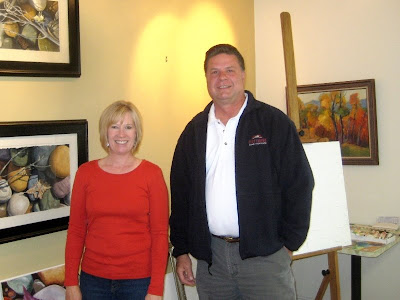 Artist Artists Roland Lee and Dianne Johnson Adams in her painting studio