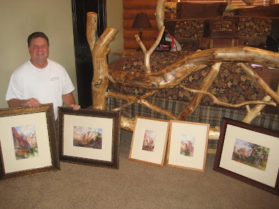 Roland Lee with plein air paintings of Zion National Park ready for the
