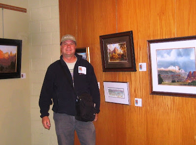 Roland Lee painting on display with Thomas Moran sketchbook at Zion National Park Gallery