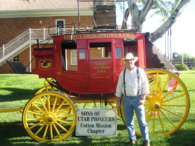 Roland Lee in front of Dean Terry's Stage Coach at Washington Cotton Days Festival