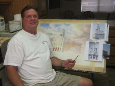 Roland Lee at work on a painting of the Nauvoo Temple