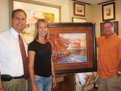 Sullivans with painting of Lake Powell Cliffs by Roland Lee
