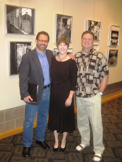 Photographer Ernesto Perez and his wife Tanya with artist Roland Lee at the Eccles Gallery at Dixie State College