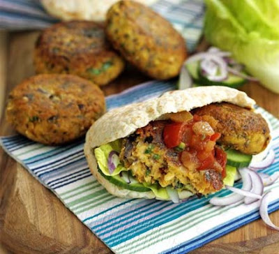 Falafel are small deep fried balls of a paste made with chick peas ...