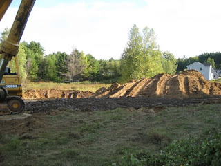 picture of clearing loam off a building lot