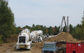picture of concrete pump truck and concrete trucks