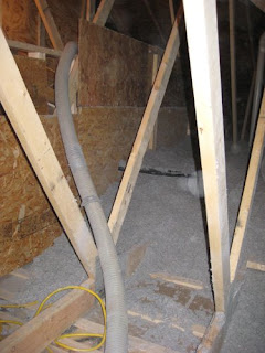 picture of cellulose insulation being installed in an attic