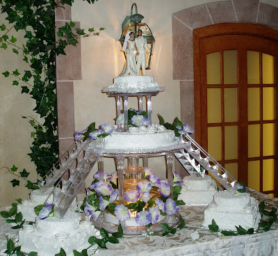 Multi-layered Wedding Cake with Stairs and Fountain