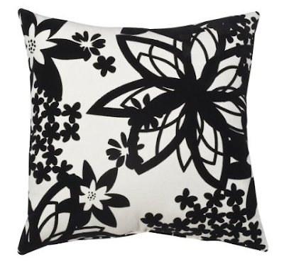 this Juno Decorative Pillow featuring an exotic black and white pattern.