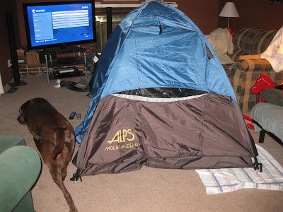 setting up tent in living room, practice camping