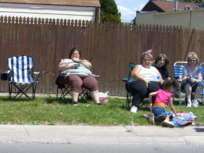 fat people at parades, love, lawn chairs, candy