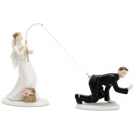 wedding cake topper with groom on the end of a hook