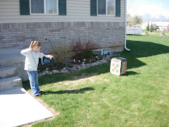 Kelsey shooting her bow, April 2007
