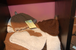 Adorable baby clothes from the farm alpacas made into hats and sweaters !