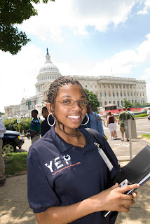 DeAndria Harris, of Albany, Ga. stands in front of the Capitol Building.