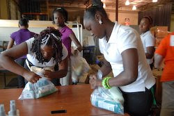 Members of a youth group volunteer creating hygiene kits for victims of Hurricane Ike.