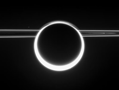 Sun shining through Titan's atmosphere with the rings behind