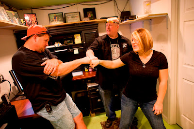Ron and Amy Shirley and Bobby Brently of Lizard Lick Towing
