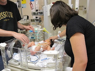 parents meeting baby in NICU
